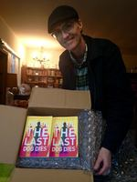 Robert Guffey with copies of Until The Last Dog Dies